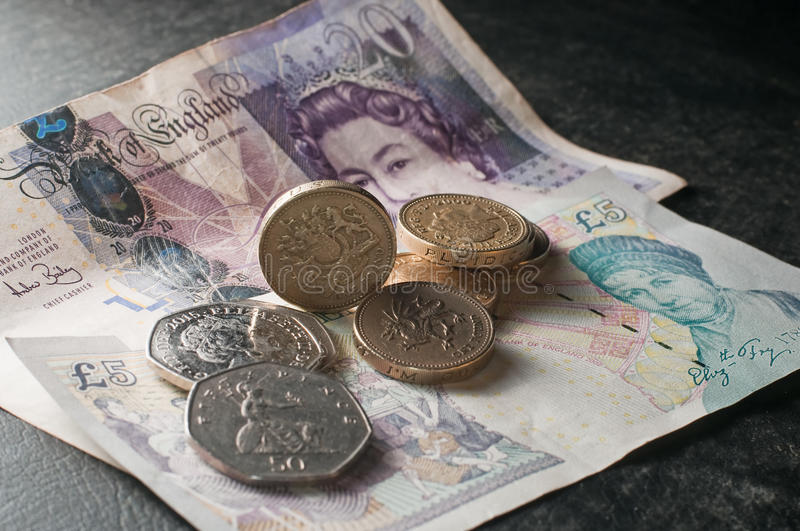 Pound sterling and coins loose money royalty free stock image