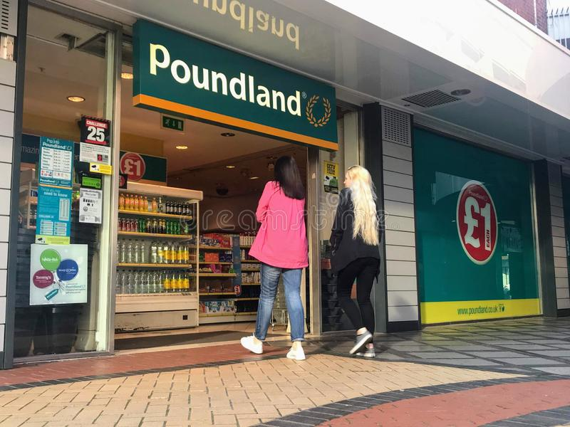 Poundland store. Poundland is a British variety store chain founded in 1990, selling most items at the single price of £1, including clearance items and stock photo