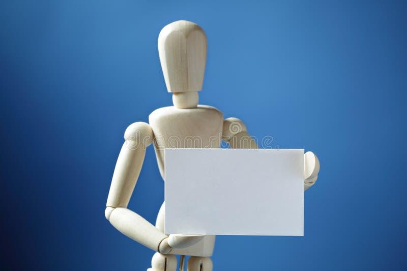 Poupée d'artiste avec la carte de visite professionnelle vierge de visite image libre de droits