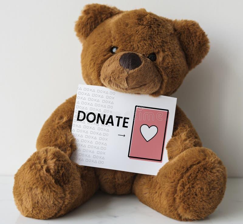 Poupée d'ours avec une carte de donation images libres de droits
