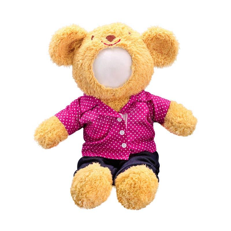 Poupée d'ours de nounours d'isolement sur le fond blanc La poupée de l'ours dans l'uniforme rose Jouet vide de visage pour la con images libres de droits