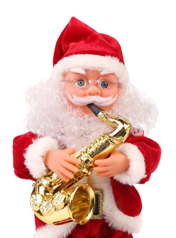 Poupée de Santa Claus avec le saxophone. photographie stock