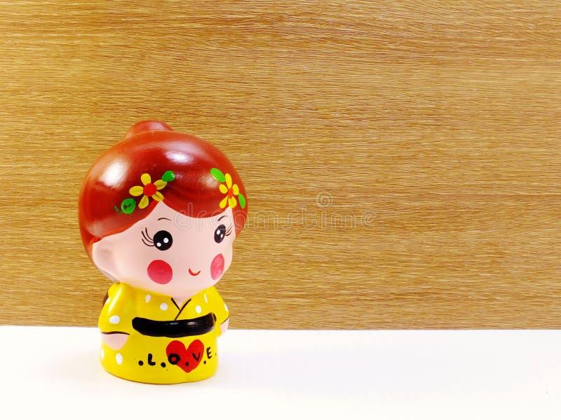 Poupée en céramique de fille japonaise mignonne photographie stock