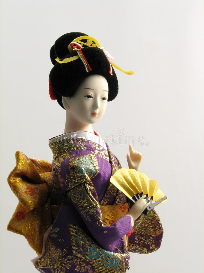 Poupée japonaise avec le ventilateur image libre de droits