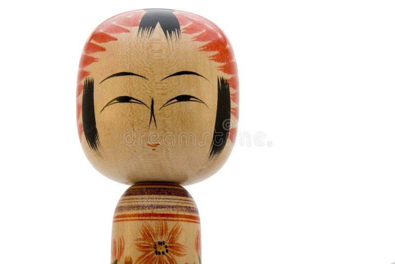 Poupée japonaise sur le fond blanc stockfotografie