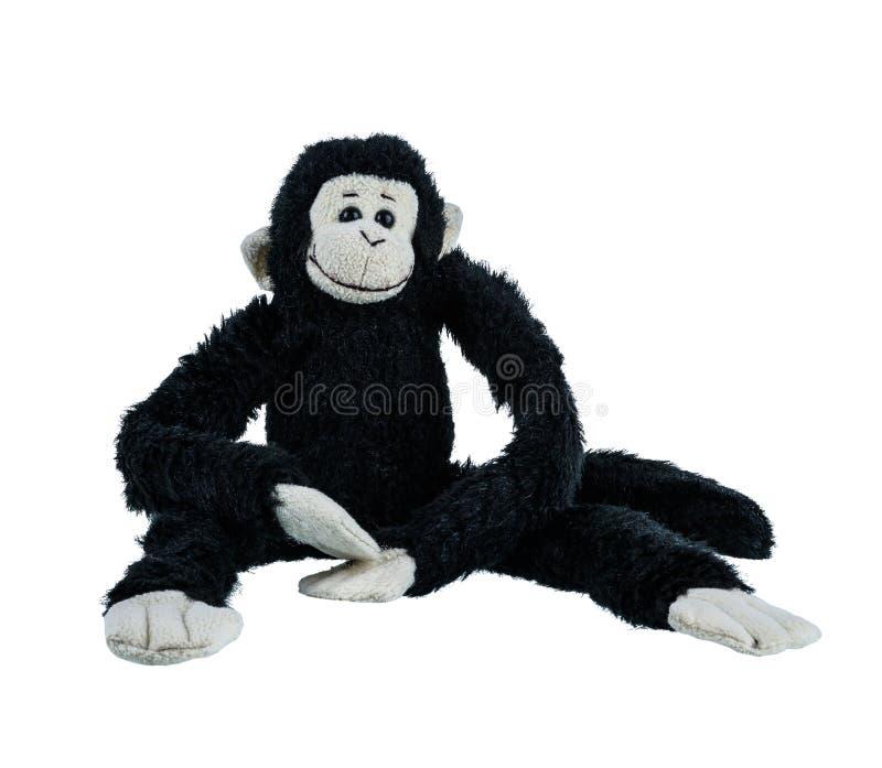 Poupée noire de singe d'isolement sur le fond blanc images stock