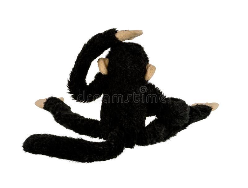 Poupée noire de singe d'isolement sur le fond blanc photos libres de droits