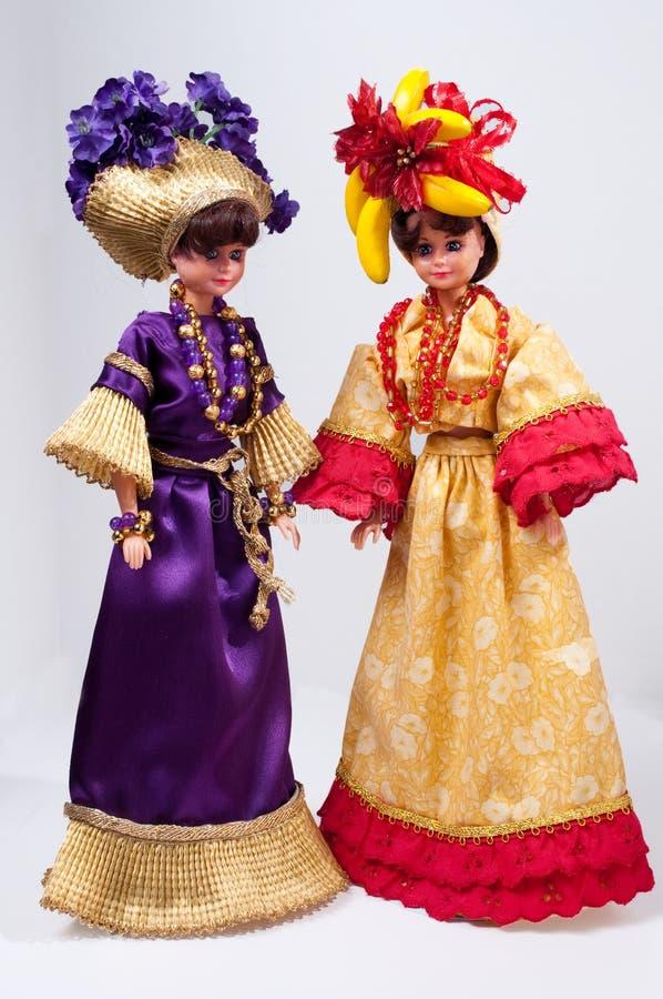 Poupées de jouet avec la robe pourprée et rouge photographie stock libre de droits