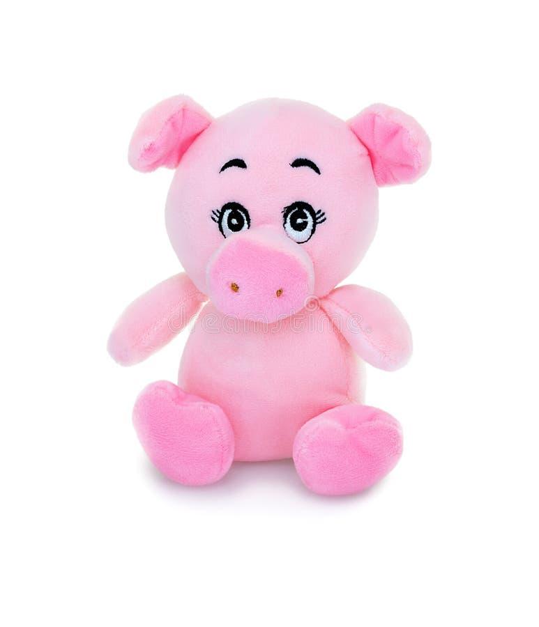 Poup?e de plushie de porc d'isolement sur le fond blanc avec la r?flexion d'ombre La peluche de porc a bourré la marionnette sur  image stock
