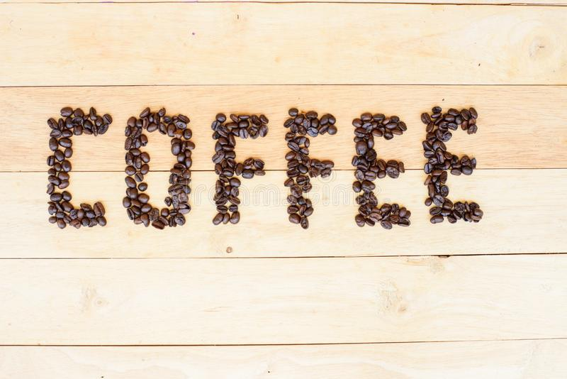 Coffee bean in COFFEE word. Pour the coffee bean move to COFFEE word stock images