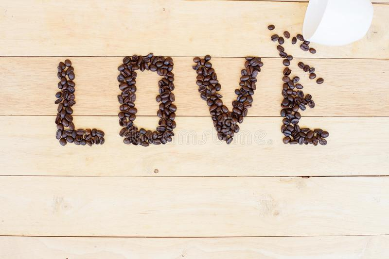 Coffee bean in LOVE word. Pour the coffee bean move to LOVE word royalty free stock photo