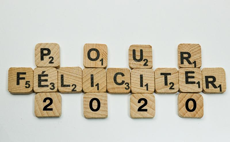 Pour Félicites 2020 and Happy New year. Few letters for card royalty free stock photo