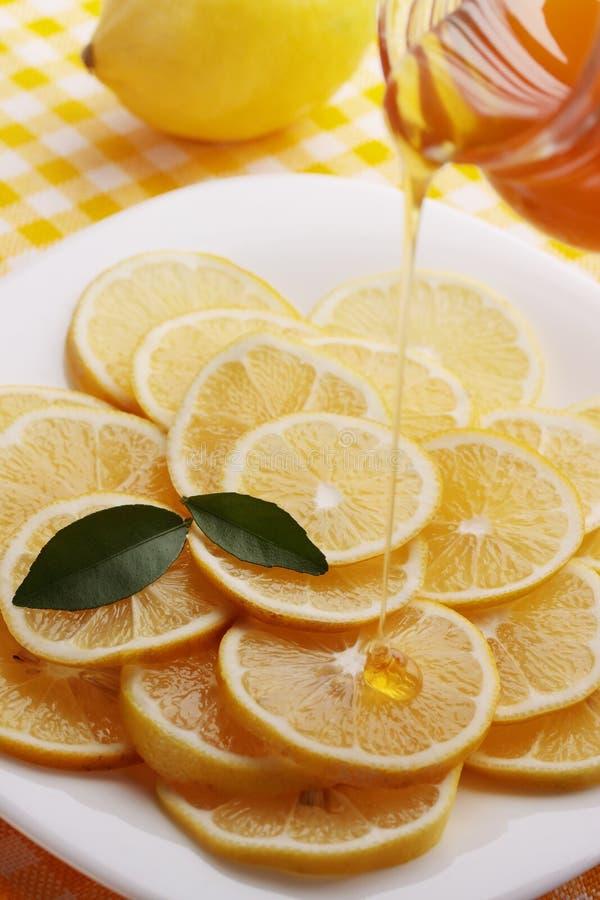 Pour honey lemon slices royalty free stock image