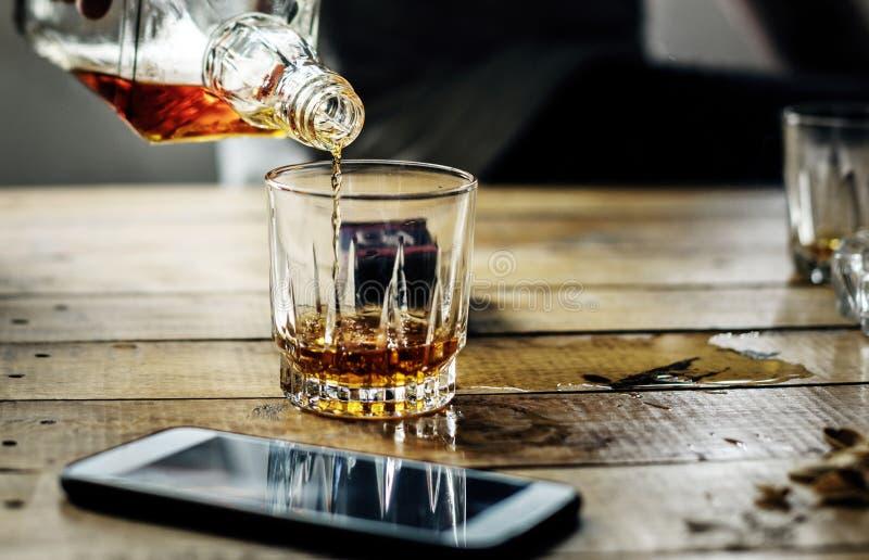 Pour liquor in a glass.  stock photos