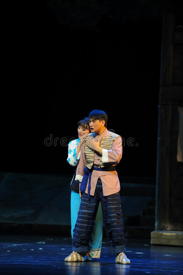 Pour out- Jiangxi opera a steelyard. Jiangxi opera a steelyard is adapted from a true story: the last century fortys, the protagonists father runs an oil mill in stock photo