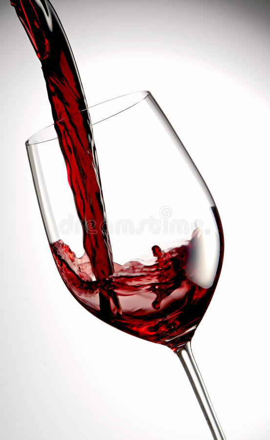 Pour red wine stock photos
