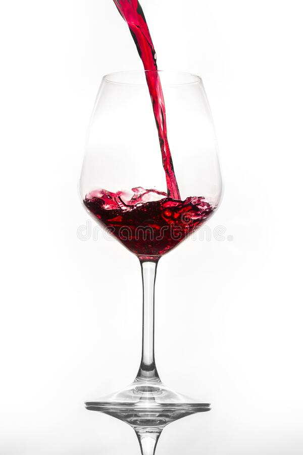 Pour red wine into the glass stock photos