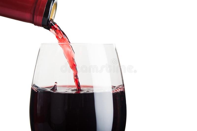 Pour wine ginto glass stock photo