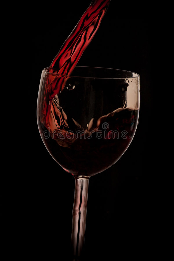Download Pour The Wine Into The Glass On A Black Background Stock Photo - Image of wine, glassware: 8575606