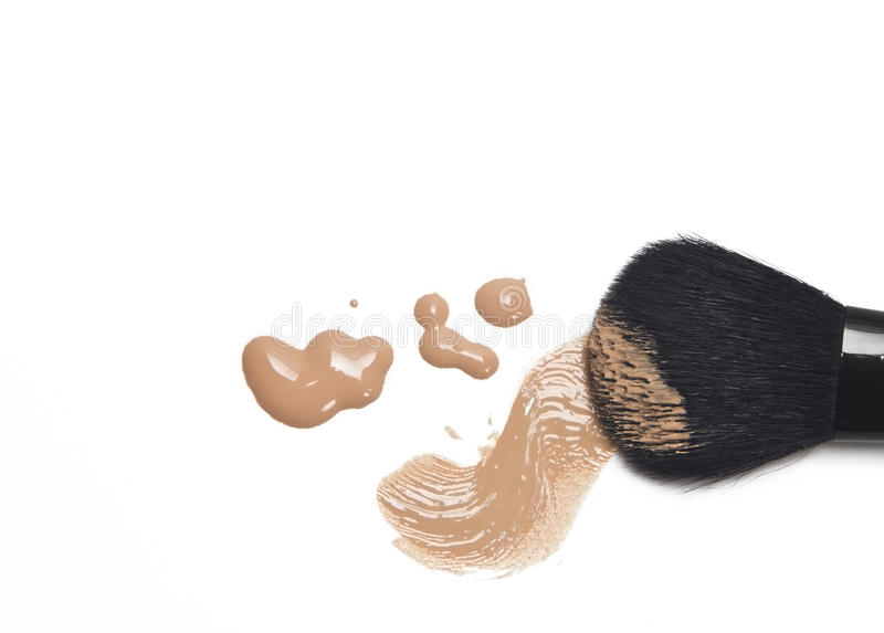 Foundation with makeup brush royalty free stock photography