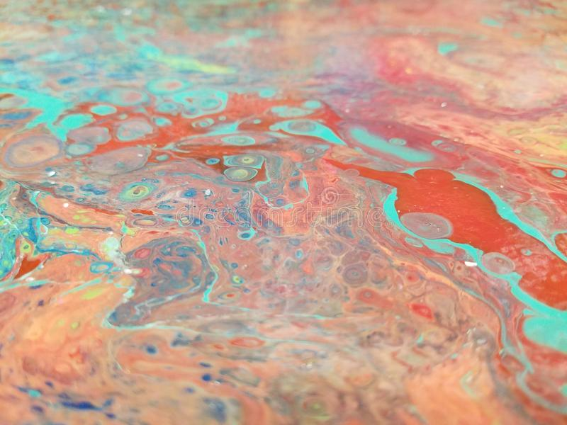 Poured Paint. Red blue turquoise painted pouring royalty free stock images