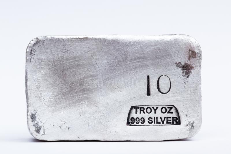 Poured Silver bar. Close up of a 10 gram bar of poured silver as a precious metal holding royalty free stock images
