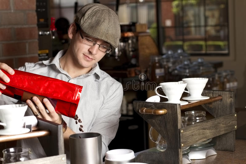 Pouring beans left stock images