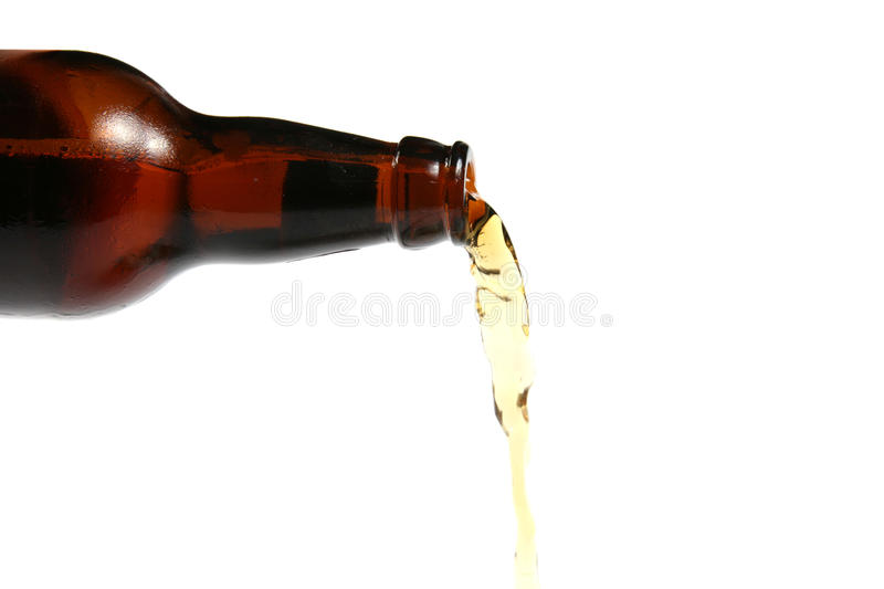 Pouring beer. Over white background stock image