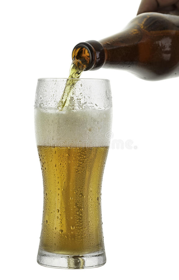 Pouring beer. In a glass stock image