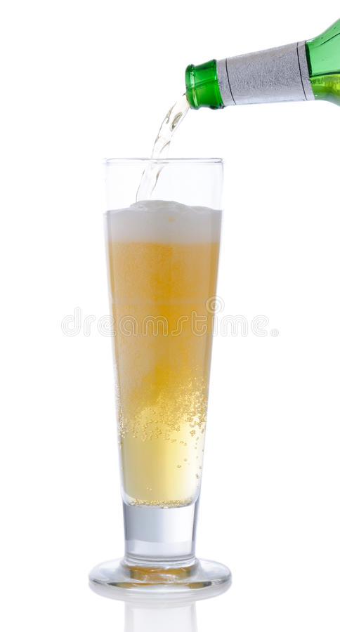 Pouring beer. Into a glass royalty free stock photos