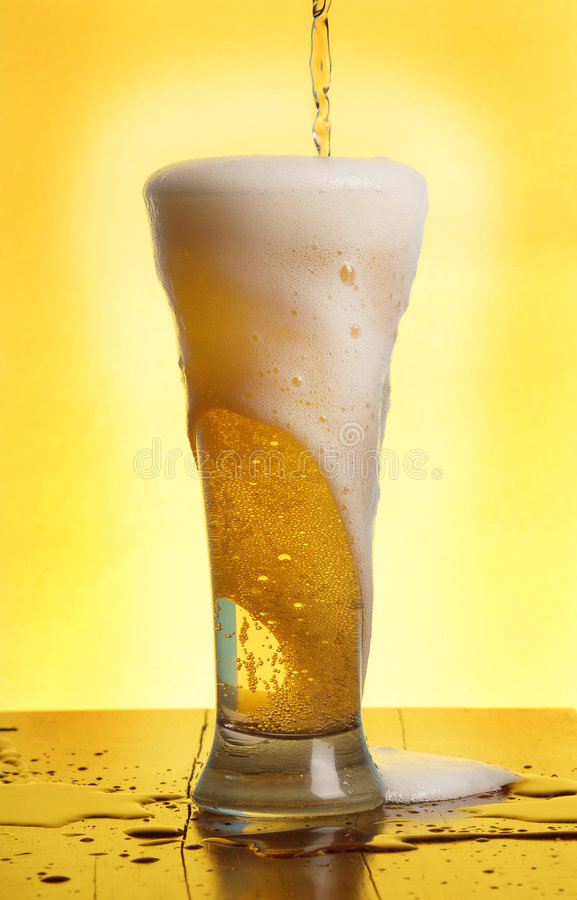Pouring a beer stock images