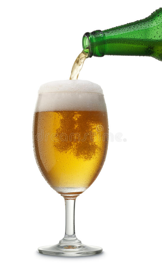 Pouring beer. Pouring a glass of beer from bottle royalty free stock photos