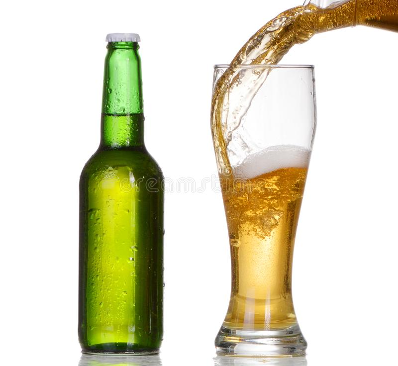 Pouring beer from bottle isolated on white. Background stock photos