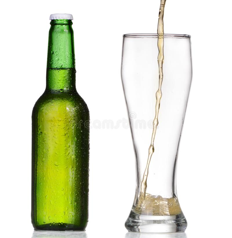 Pouring beer from bottle isolated on white. Background stock images