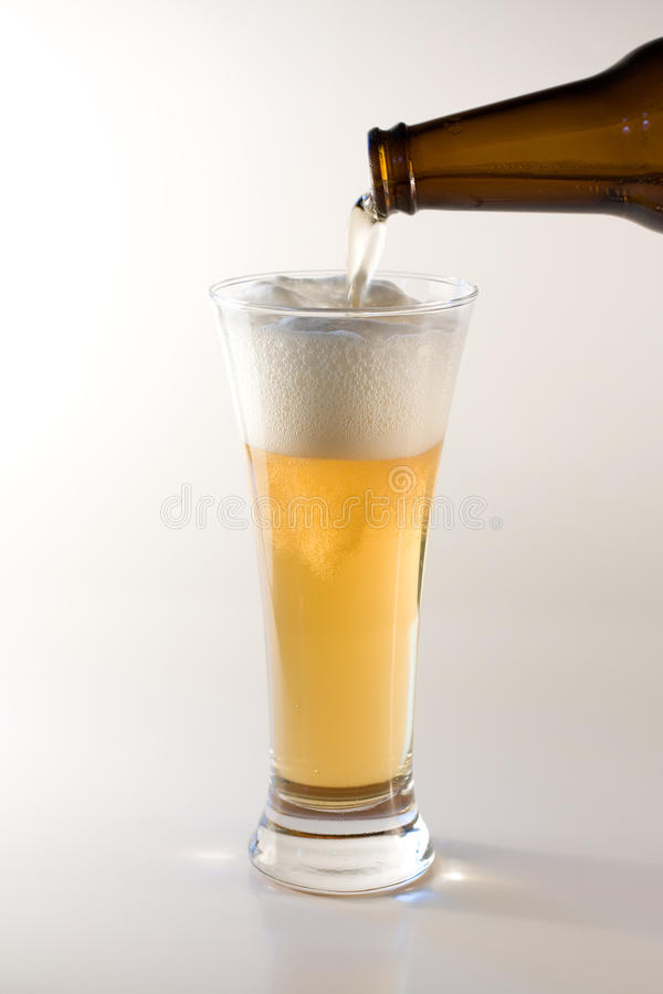 Download Pouring beer in glass stock image. Image of beer, drinking - 12534213