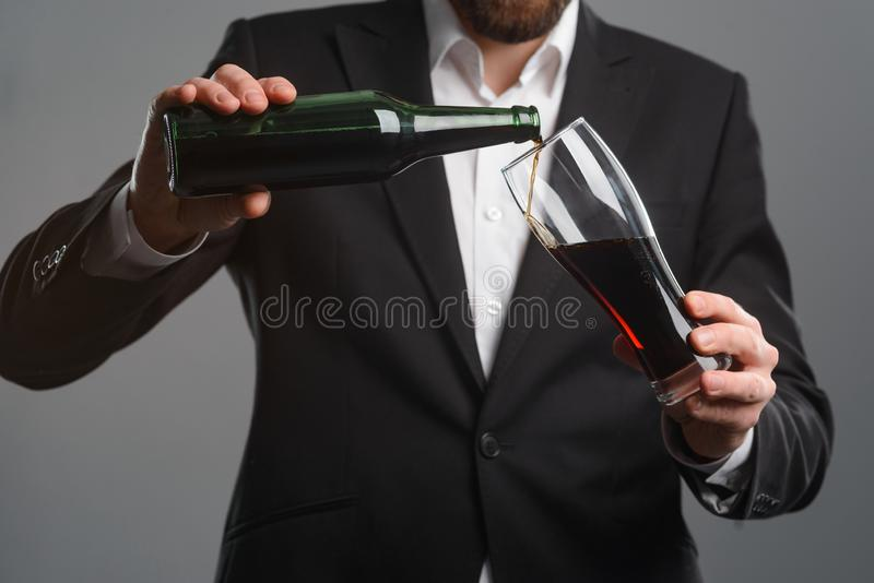 Pouring beer into a glass royalty free stock photos
