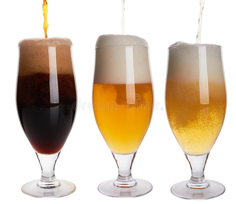 Pouring Beer into glass. On white background stock image
