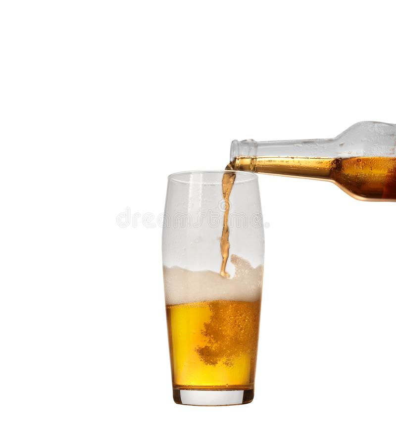 Pouring beer. Into a beer mug on a white background stock photo
