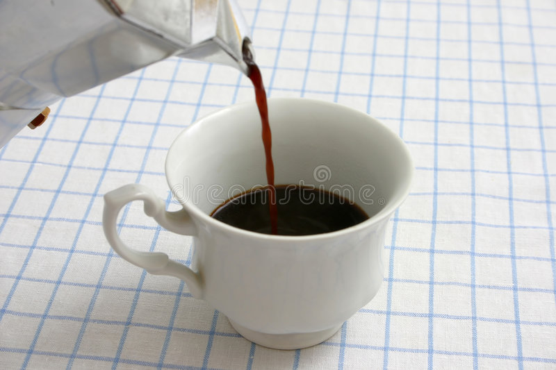 Pouring black coffee stock images