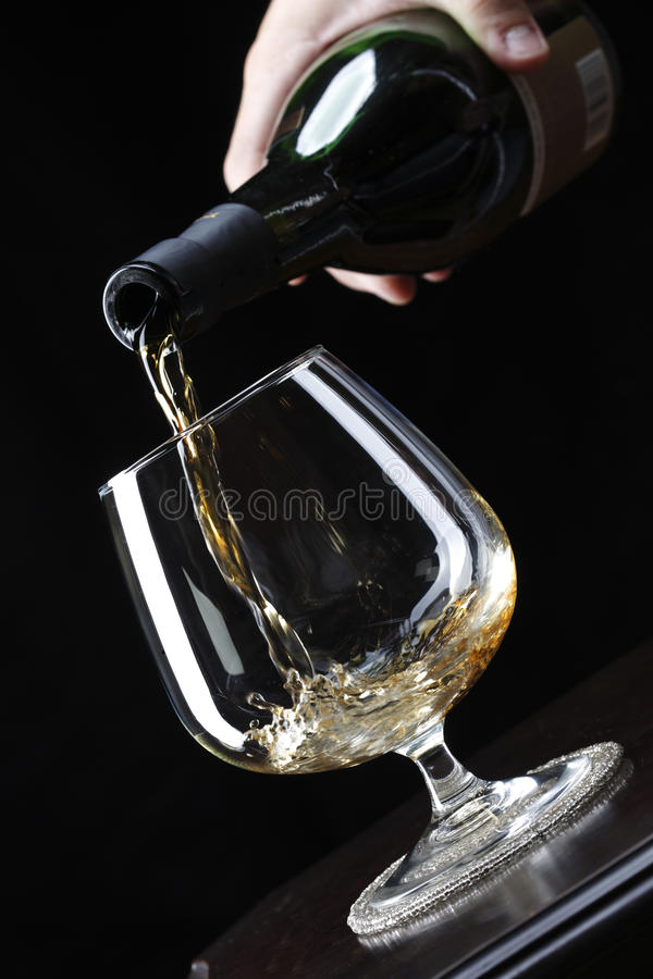Pouring brandy royalty free stock image