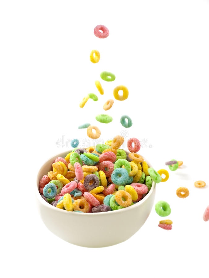 Pouring breakfast cereals. Only on white background stock photos