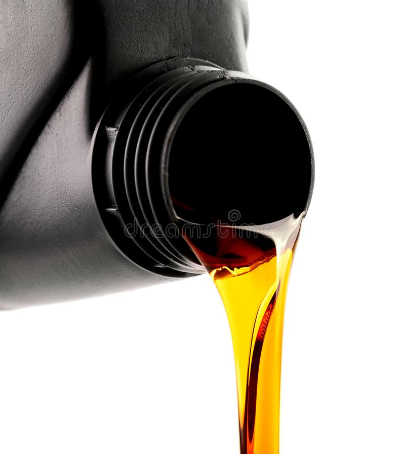 pouring car engine oil from bottle isolated on white royalty free stock photography