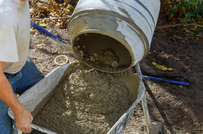 Pouring cement during paving concrete pavement near the house. Pouring cement during paving concrete pavement near the driveway royalty free stock image