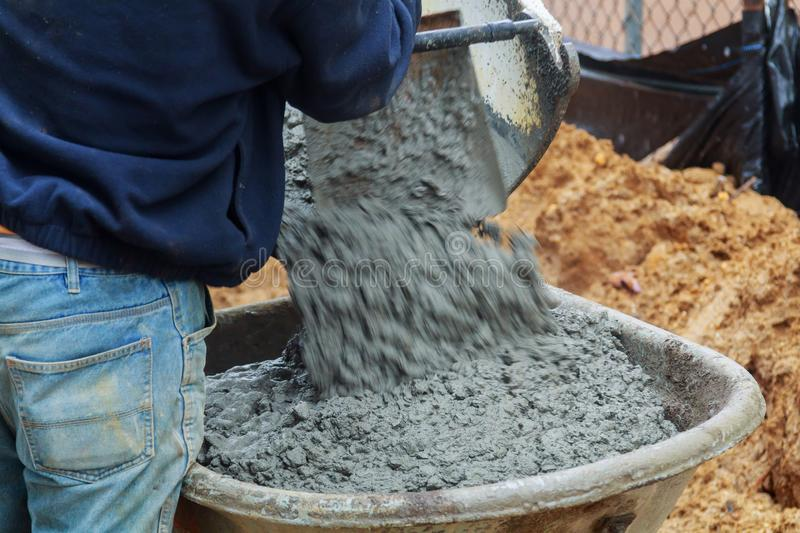 Pouring cement during sidewalk paving concrete pavement near the house. Pouring cement during sidewalk paving concrete pavement near the driveway patio stock images