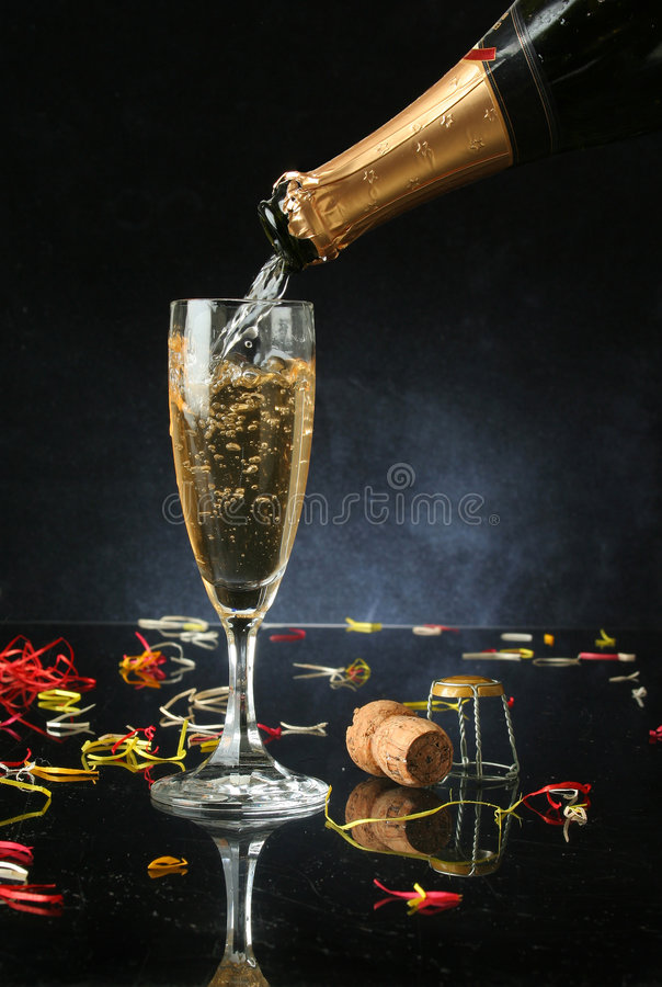 Pouring a champagne flute stock photography