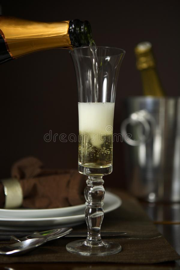Pouring Champagne into a flute royalty free stock image