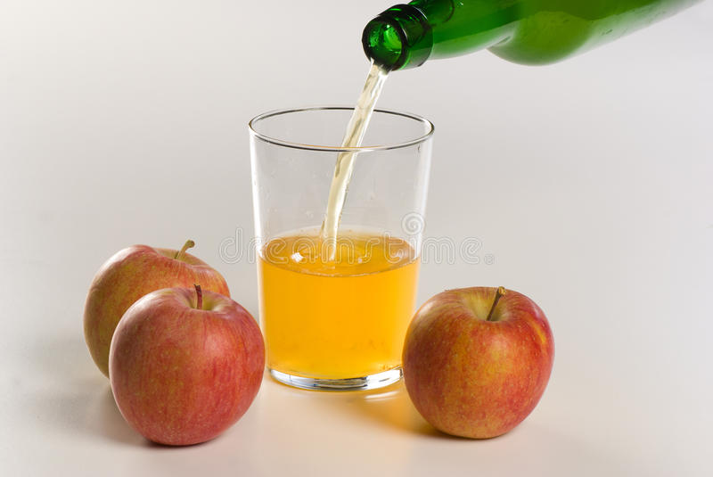Pouring cider. Pouring traditional homemade cider, unfiltered and organic royalty free stock photography