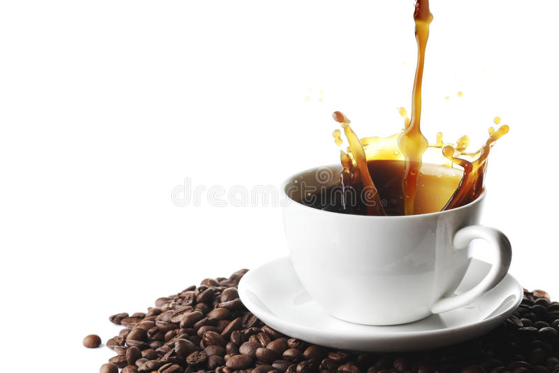 Pouring coffee in cup stock photo