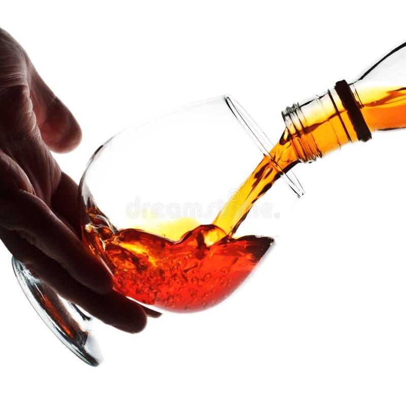 Pouring Cognac stock images