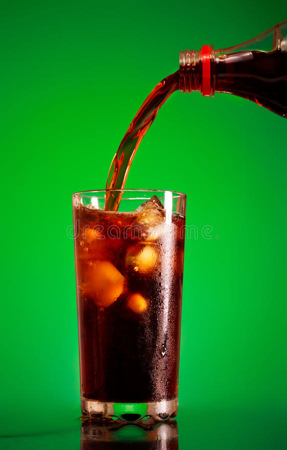 Pouring Cola stock photos